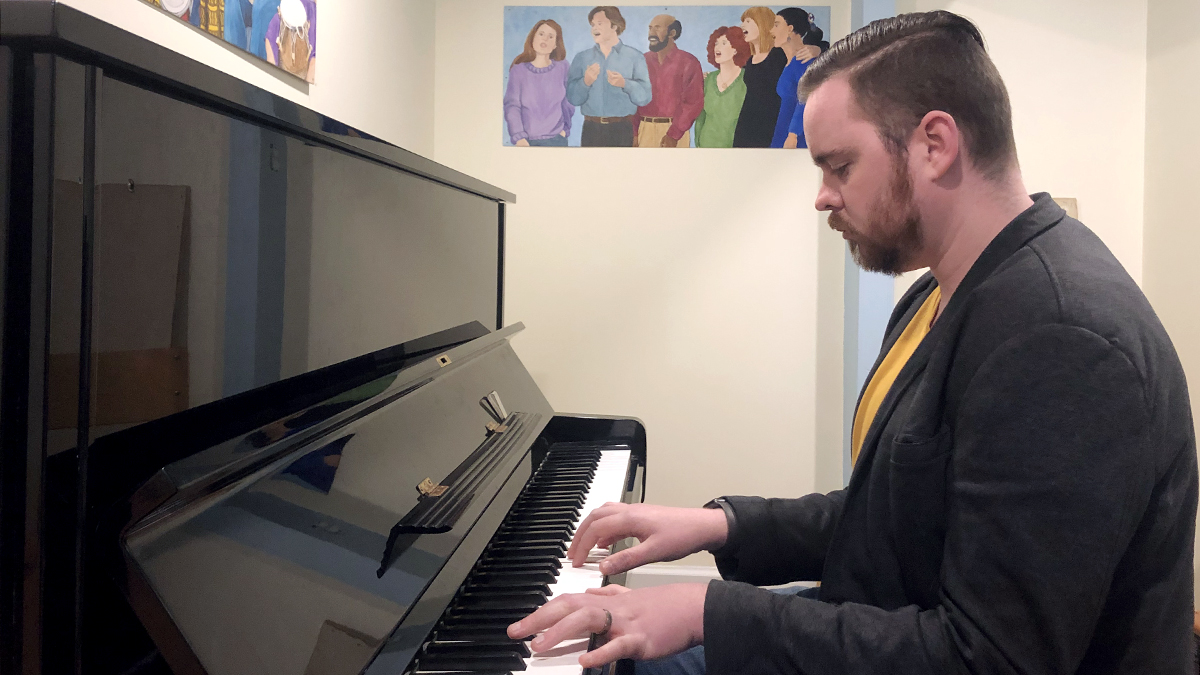 Andrew Knox plays the piano.
