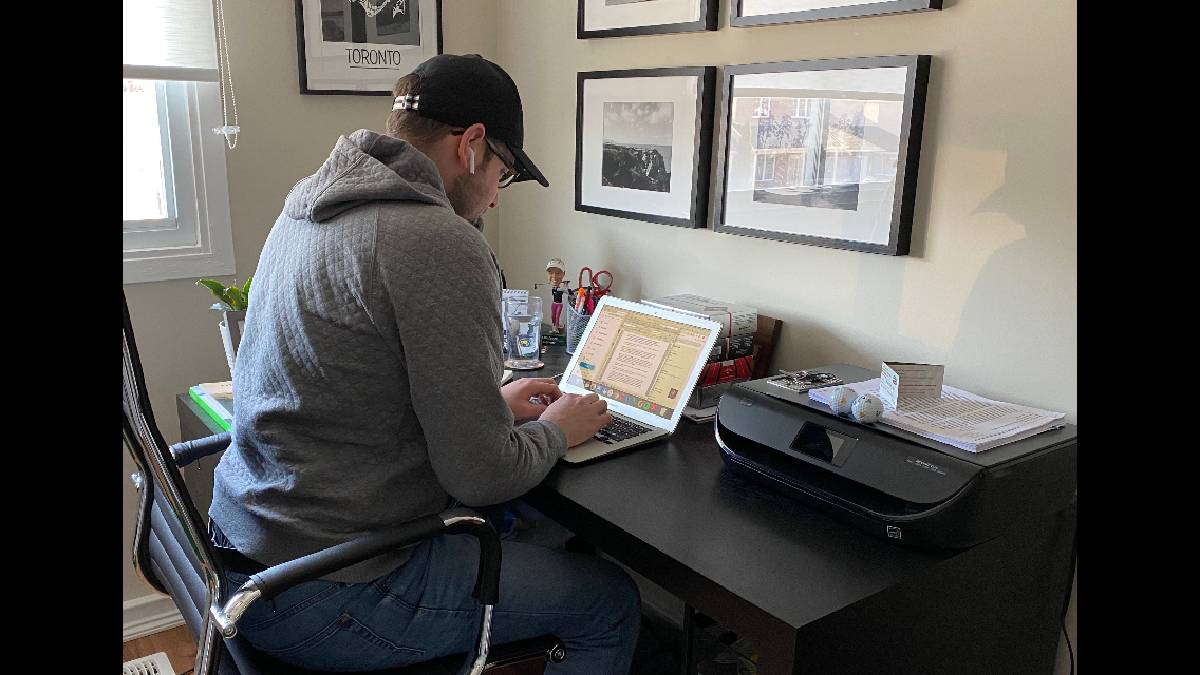 Journalist Adam Stanley works in his home office.
