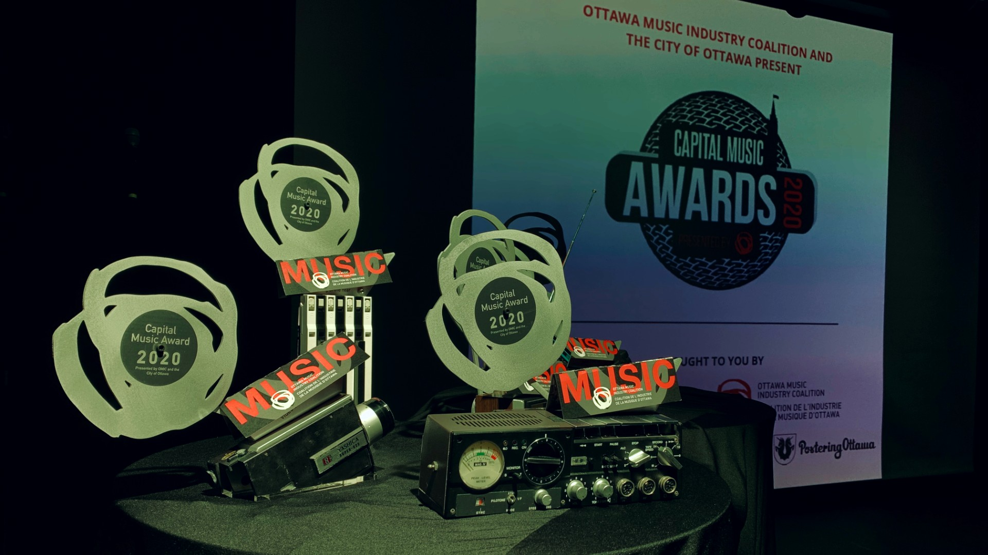 Trophies for the Capital Music Awards line are displayed on stage.