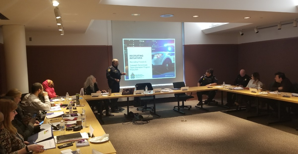 Two officers present to the Ottawa Police Services Community Equity Council.