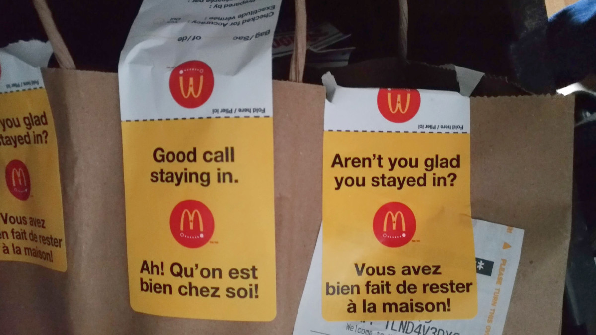 A paper bag with McDonald's UberEats stickers.