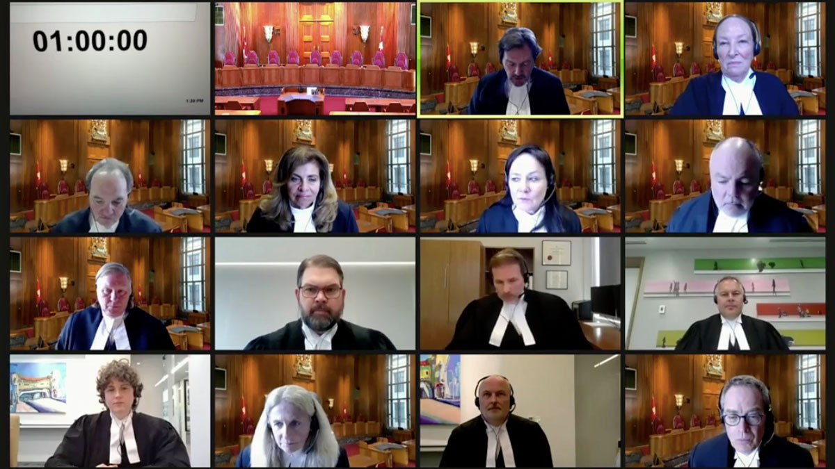 A laptop screenshot shows all judges and lawyers from the Supreme Court hearing