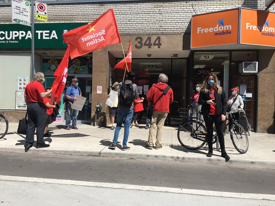 ACORN members rally outside a downtown Toronto office