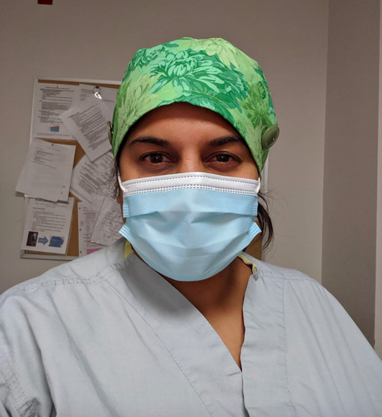 Hanmiah puts on a mask as soon as she enters the hospital and wears it for the duration of her shift.