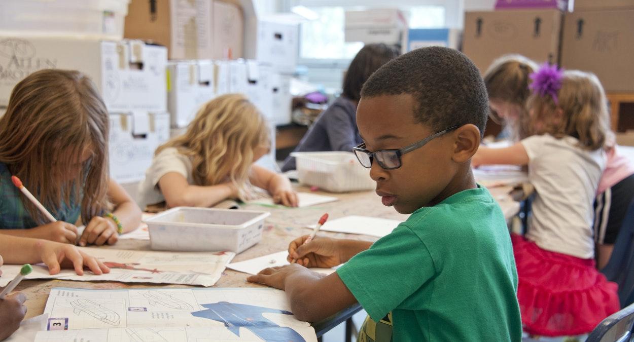 Children working in a classroom.