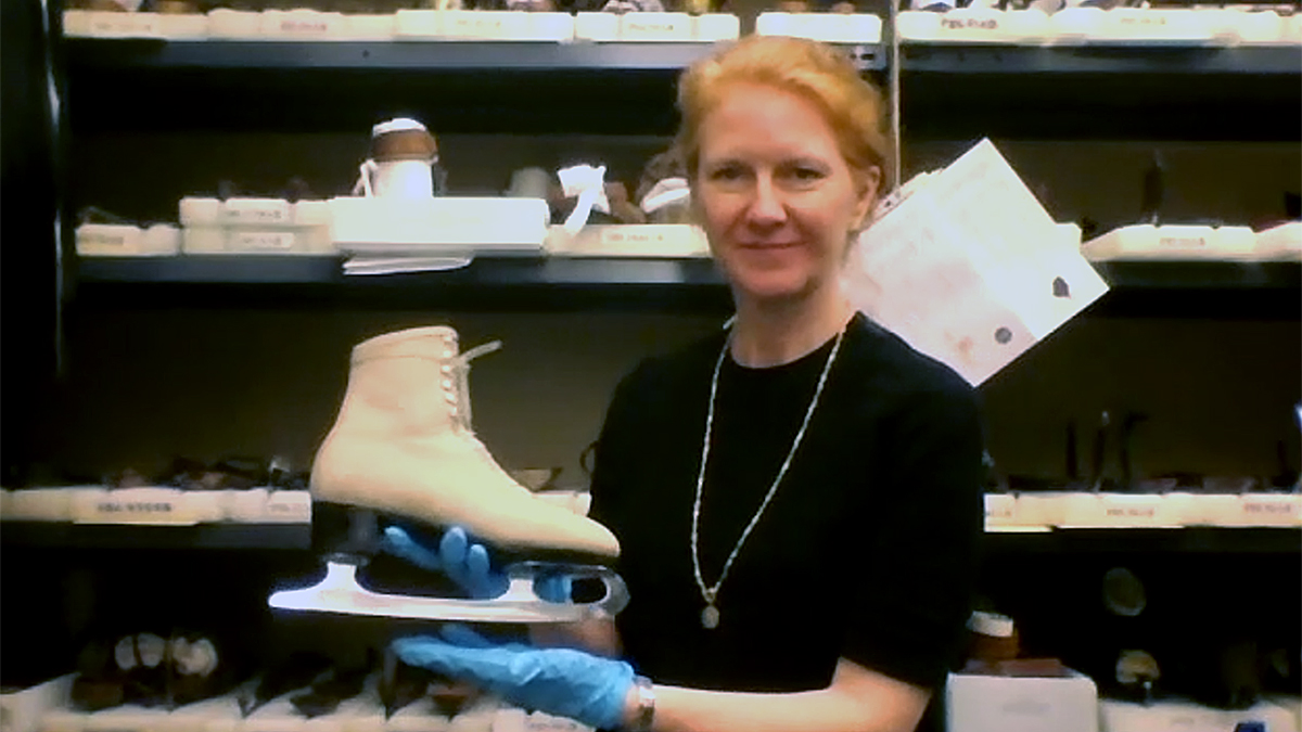 Suzanne Petersen, holds a white skate worn during the 1960s