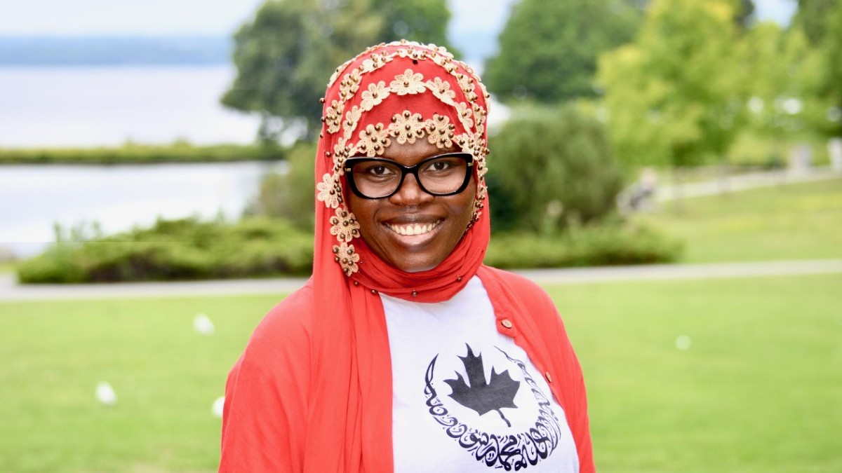 Portrait of Sahada Alolo in Ottawa Muslim Women's Organization shirt