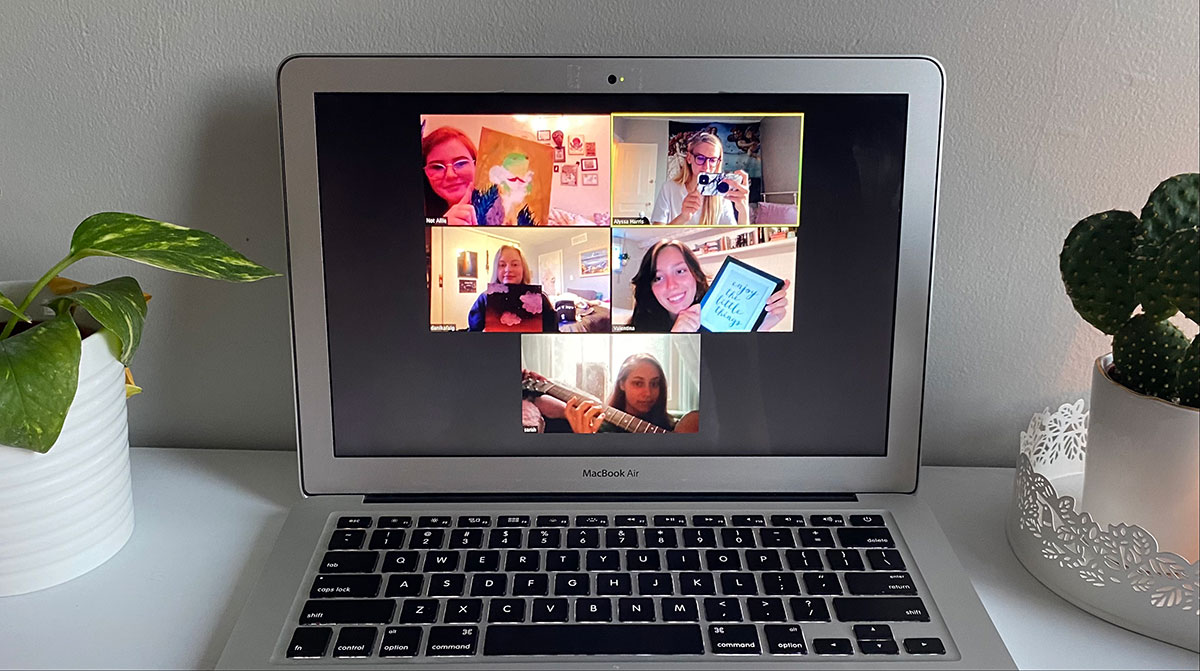 Picture of Macbook with Zoom meeting open.