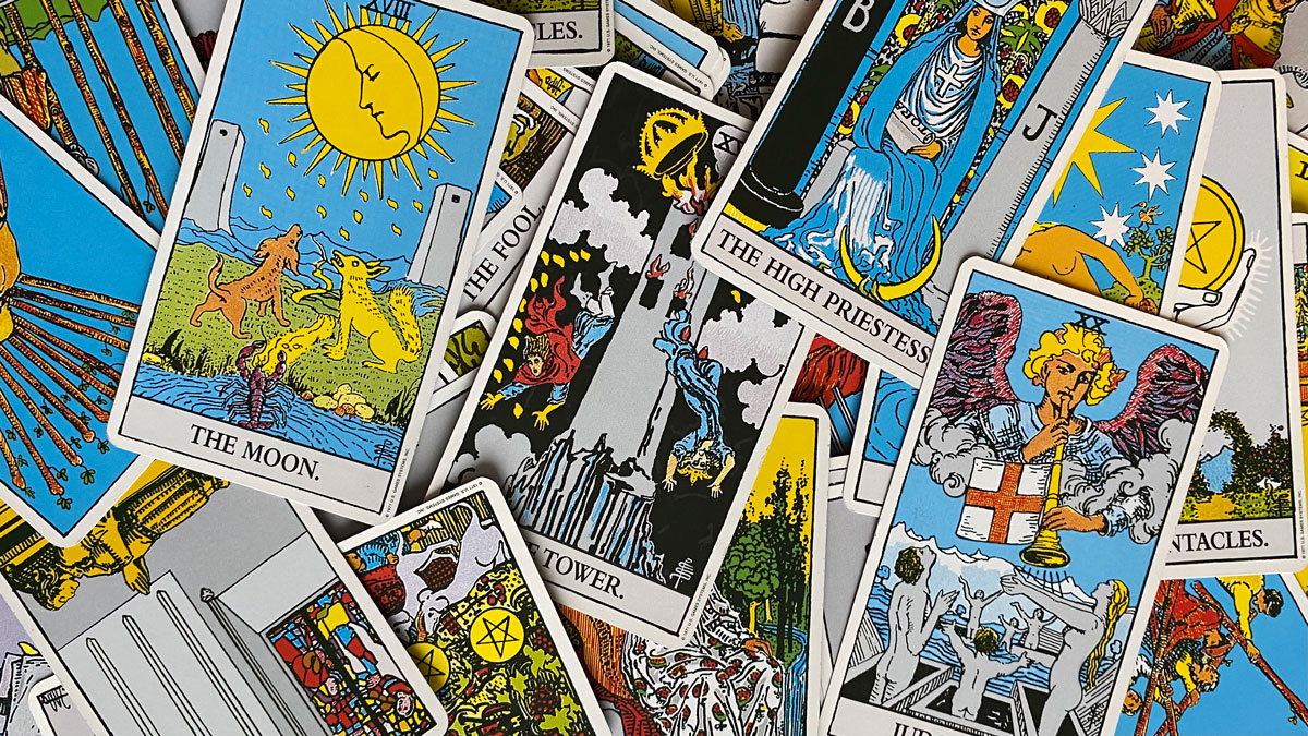 an array of tarot cards including: the moon, the tower, the high priestess.