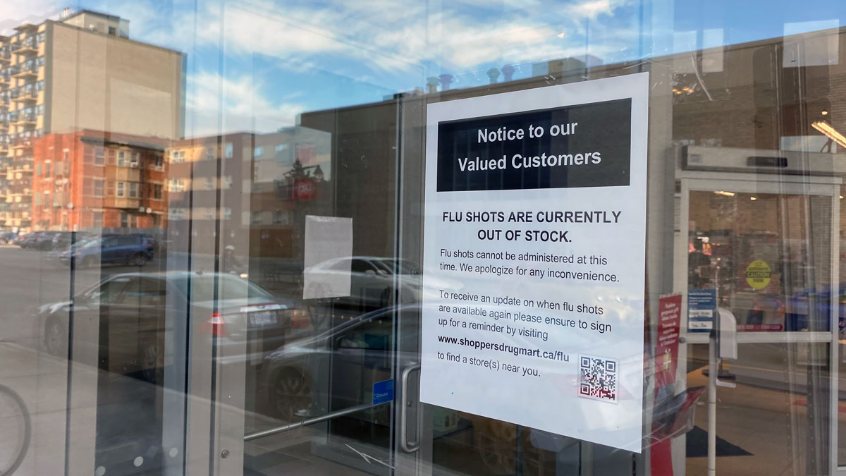 Photo of sign posted on Shoppers Drug Mart door reading: Notice to our Valued Customers, Flu Shots are Currently out of Stock. Flu shots cannot be administered at this time. We apologize for any inconvenience.