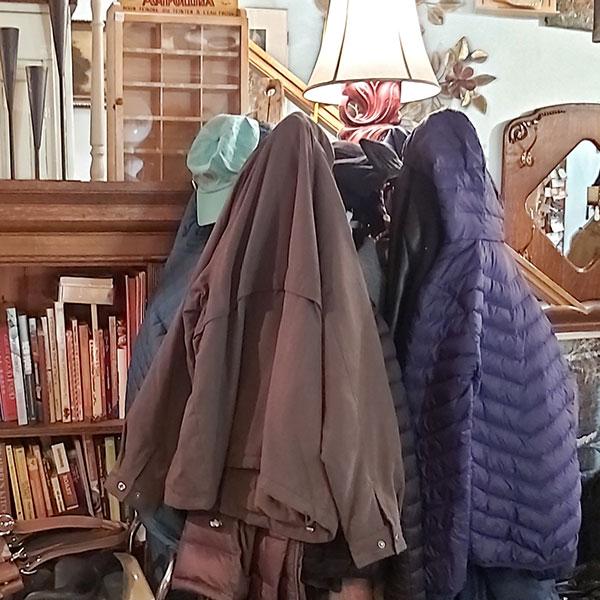 Donated winter jackets on a coatrack in highjinx.