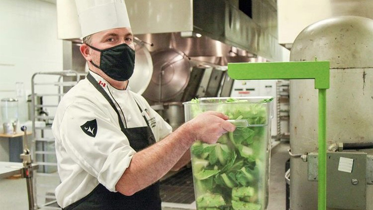 A chef is pictured placing avocado remains on a scale