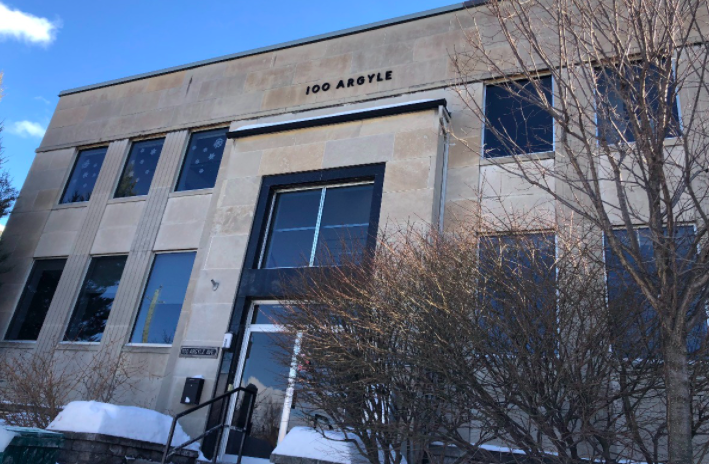 City approves plan to save building's facade before demolition and rebuild at site facing nature museum