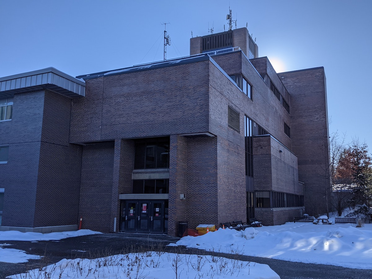One of the University Centre entrances is pictured, with snow on either side of the doorway.