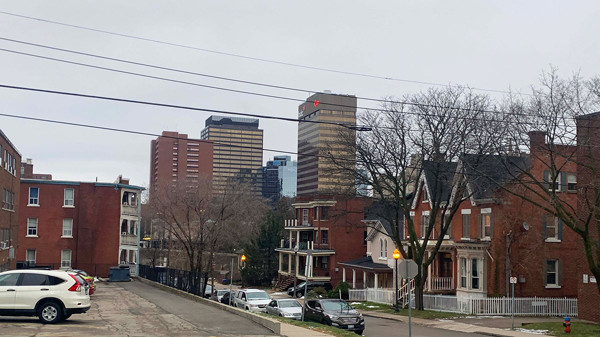 Photo shows houses and apartment buildings in downtown Hamilton
