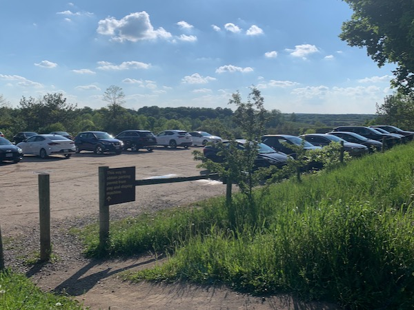 A parking lot filled with cars.