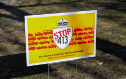 lawn sign shows message STOP the 413