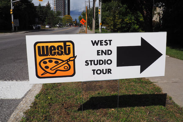 West End Studio Tour sign pointing towards studio on side of road.