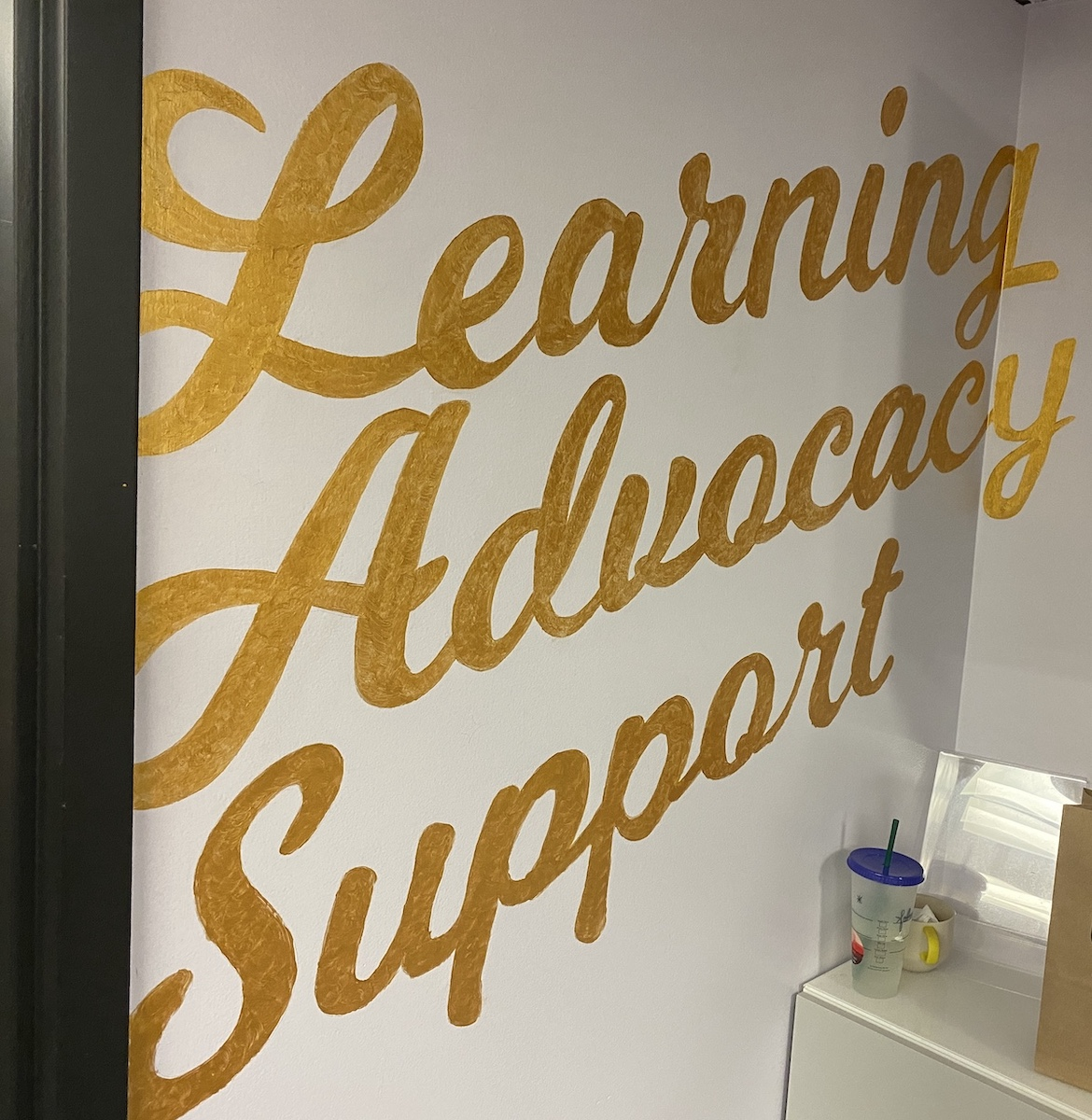 The walls of Carleton University's Womxn's Centre read learning, advocacy, and support for survivors of sexual violence.