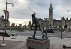Image shows statue of Terry Fox with Parliament Buildings in background