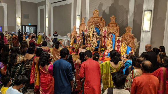 People worshipping the idol of goddess Durga.
