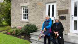 Martha Edmond and Janet Uren, co-authors of a history of New Edinburgh, stand in front of the Frasier Schoolhouse