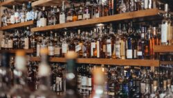 Alcohol bottles on shelves at the Glenesk Hotel in Edzell, UK.